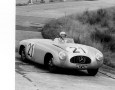 No. 21 Mercedes SL, driven by Hermann Lang,  comes around a corner.