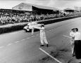 1952 Mercedes-Benz 300 SL W194 passing a Mercedes Staff Technician signaling racers