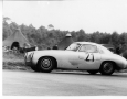 1952 Mercedes-Benz 300 SL W194 coming around a curve and driven by race winner Herman Lang at the 24 hours Le Mans race in 1952.