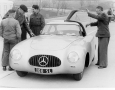 """Karl Kling opening the """"Gullwing"""" door on the drivers side of the 1952 Mercedes-Benz 300 SL W194"""