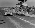 Karl Kling and Juan Manuel Fangio driving at the Grand Prix of France 1954