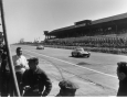 Reis on a straight-away in front of the boxes at the 1000 KM race at Nurburgring in 1957.