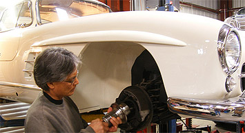 Professional Restoration Mechanic working on a Mercedes-Benz Gullwing in our shop