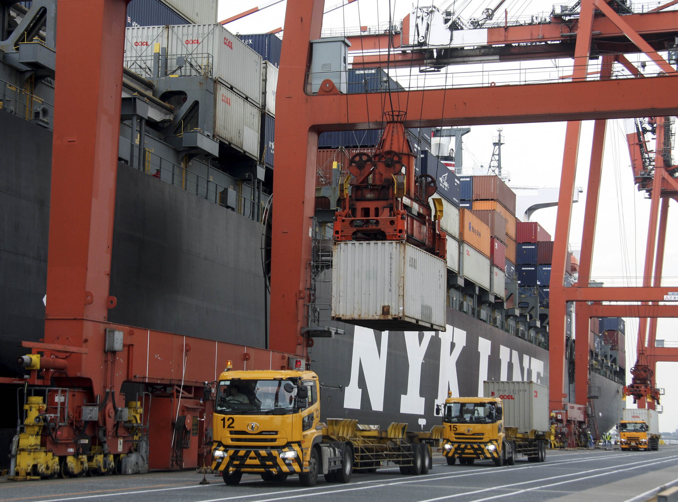 A container is unloaded from a truck onto a ship at a container terminal in Tokyo, Japan, on Friday, Sep 26, 2008. Photographer: Haruyoshi Yamaguchi/Bloomberg News
