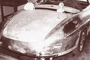 A badly damaged vintage car before restoration